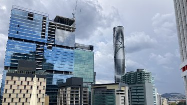 Dark cloud roll in over Brisbane City on Friday morning.