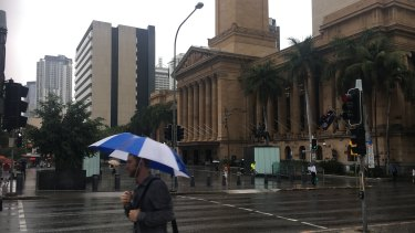 Brollies were the go in the Brisbane CBD for much of Thursday morning and early afternoon. (File image)