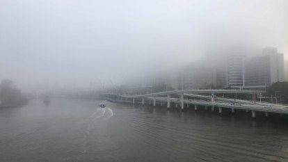 Fog blankets Brisbane, causing crashes on roads
