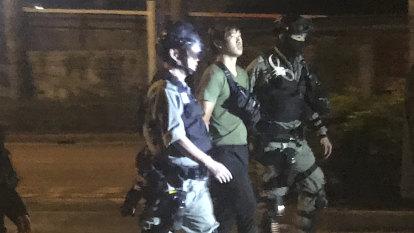 Hong Kong principals escort minors from university siege, as worried parents watch