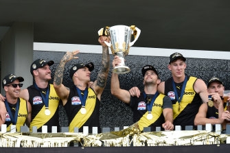 GOLD COAST, AUSTRALIA - OCTOBER 25: (L-R) Dustin Martin and Trent Cotchin hold the Premiership Trophy aloft at Elite Gold Coast on October 25, 2020 in Gold Coast, Australia. The Richmond Tigers defeated the Geelong Cats in last night's 2020 AFL Grand Final. (Photo by Matt Roberts/Getty Images)