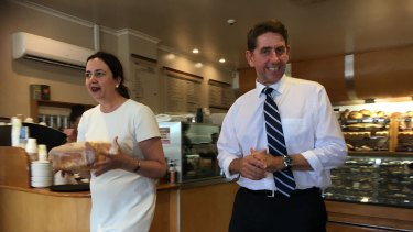 Premier Annastacia Palaszczuk and Treasurer Cameron Dick pick up some bread at a bakery in Woombye.