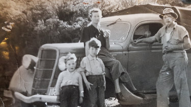 The Robson family (from left, the author, brother Rob, mother Pat and FNick) on the road in NZ's Northland in the 1950s.