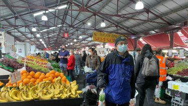 Masked-up Melburnians at Queen Victoria Market's fruit and vegetable section late last year.