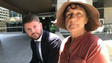 Bimblebox Nature Refuge co-owner Paola Cassoni with Environmental Defenders Office chief executive David Morris outside Queensland's Law Courts.