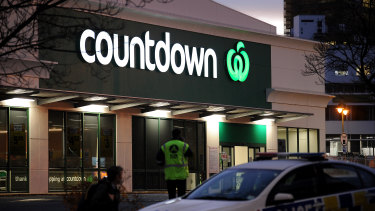A police car is observed blocking an entrance to the Dunedin Central Countdown in Dunedin, New Zealand.