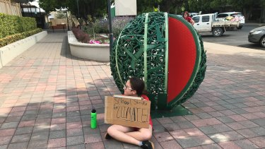 Nearly four hours' drive west of Brisbane at the small town of Chinchilla, Ariel Ehlers staged her own strike outside Chinchilla State School.