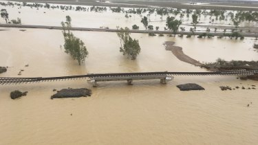 Aerial view of the Mount Isa rail line east of Julia Creek, taken in early February as the flood peaked in the area.