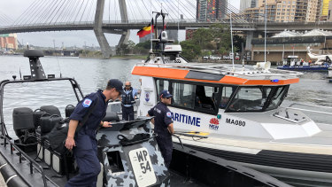 Police raid a boat owned by All Occasions Cruises in Blackwattle Bay Marine in Pyrmont.