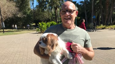 Todd Simpson and his King Charles spaniel Daisy will be able to travel on Brisbane's CityCats before Christmas.