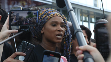 Assa Traore, sister of Adama Traore, answers reporters outside the Palace of Justice in Paris.