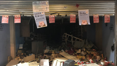 Protesters left a note explaining why this Chinese store on Nathan Road, Hong Kong, was ransacked.