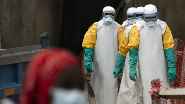 Health workers dressed in protective gear begin their shift at an Ebola treatment centre in Beni in the Democratic Republic of Congo.