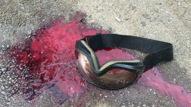 Blood and goggles left on road after police moved in at Hong Kong Polytechnic University.
