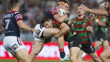Cameron Murray up-ends Roosters forward Angus Crichton at ANZ Stadium on Thursday night.