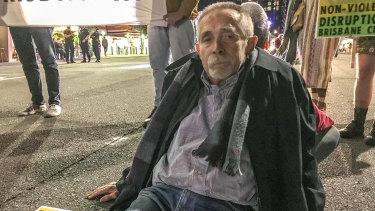 Brisbane man Frank Moeller glued his fingers to Grey Street on Friday night.