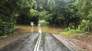 The Behana Creek causeway on Sunday morning, where councillor Brett Moller rescued a woman who drove into the flooded causeway.
