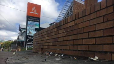 The car collided with this brick wall outside the Woolloongabba church.
