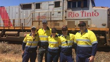 Rio Tinto Iron Ore AutoHaul team celebrating the success of the first autonomous rail journey fromWombat Junction to Paraburdoo.