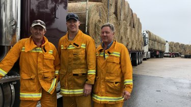 Convoys of hay at Bairnsdale, ready to distribute to farms.