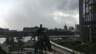 Storms arrive above Parliament House and 1 William Street in Brisbane CBD on Thursday afternoon.