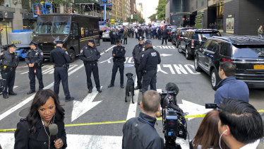 New York police cordon off several blocks around the CNN office in Manhattan on Wednesday.