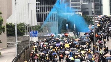 Police fire blue dye at protesters designed to identify them after they leave a scene.