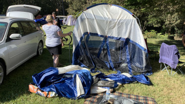 Festival goers pack up their tents on Sunday after the Falls Festival in Lorne was cancelled.