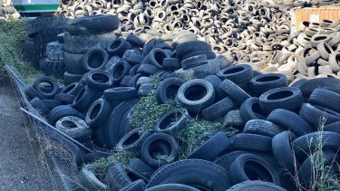 Tyres stored at Tyremil have collapsed the fence with the neighbouring transport business.