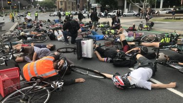 "Cyclists staged a ""die-in"" protest during Brisbane's peak hour traffic on May 2."