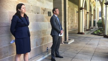 Premier Annastacia Palaszczuk and Health Minister Steven Miles watch as the Chief Health Officer explains her health advice about the Queensland-NSW border.
