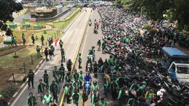 Gojek, Uber and Grab drivers shut down part of Jakarta on Tuesday to demand equal pay.