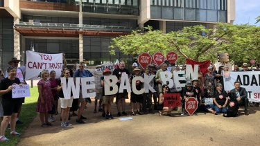 Stop Adani protesters outside the Supreme Court in Brisbane in support of Ben Pennings.