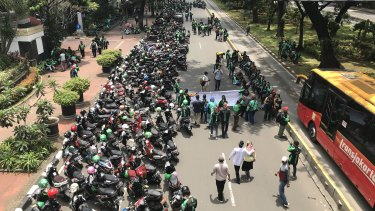 Drivers want the Indonesian government to guarantee better pay and conditions.