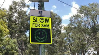 "Brisbane City Council's Slow for SAM sign, which gives motorists who obey the speed limit a ""smiley face""."