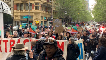 Extinction Rebellion protesters marching on Collins Street.