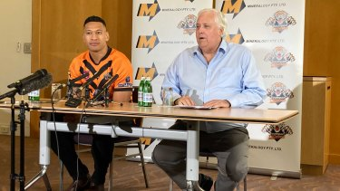 Israel Folau and Clive Palmer at their press conference at the Hilton Hotel in Brisbane on Friday.