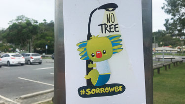 A 'Sorrowbe' sticker on a public shower near Currumbin Creek on the Gold Coast on Tuesday.