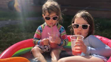 Two young Melburnians enjoy a paddling pool frappé.