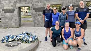 Tim Earl (top left) and Neil Sproat (top right) with their running group. Neil and Tim are cousins of Leading Senior Constable Lynette Taylor.