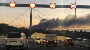 Plumes of smoke from a factory fire in Campbellfield on the approach to Melbourne early on Friday.