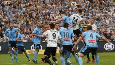 Head for heights: Connor Metcalfe nods home a goal to put Melbourne City 1-0 up.