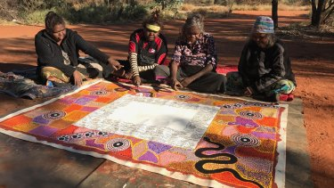 Road map for empowerment: The artists of the Uluru Statement of the Heart at Uluru in 2017.