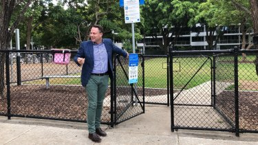 Lord mayor Adrian Schrinner swings the gates open at New Farm off-leash park.
