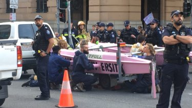 About 20 police were working to move the boat, at the Elizabeth and George streets intersection in Brisbane.