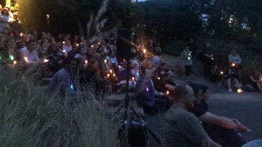 Candles are held at a vigil for Celeste Manno.