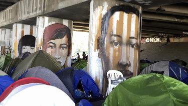 Migrants camp under a bridge in Paris.