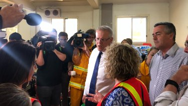 Scott Morrison and Darren Chester arrive in Bairnsdale on Friday . The PM had earlier been heckled in the NSW town of Cobargo.
