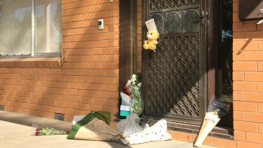 Tributes left at the home of Vicki Ramadan.