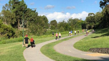 Walkers and joggers at Kedron Brook in Brisbane's northern suburbs on Sunday.